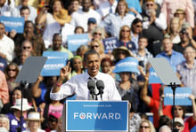 President Barack Obama talks to supporters during a campaign stop in Delray Beach, Fla., Tuesday, Oct. 23, 2012. (AP Photo/Alan Diaz)