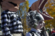 Chris Detrick     The Salt Lake Tribune The Peterson family, Bret, Stephanie, Gage, 6, and Bailey, 9, dressed as characters from Beetlejuice during the Monster Block Party at the Gallivan Center Saturday October 27, 2012. They won second place in the costume contest.