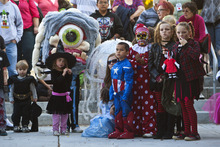 Chris Detrick     The Salt Lake Tribune Kids in various Halloween costumes participate in the costume contest during the Monster Block Party at the Gallivan Center Saturday October 27, 2012.