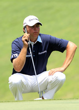 Bo Van Pelt of United States lines up a putt on the 16th hole during round three of CIMB Classic golf tournament at the Mines Resort and Golf Club in Kuala Lumpur, Malaysia, Saturday, Oct. 27, 2012.  (AP Photo/Peter Lim)
