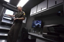 Leah Hogsten  |  The Salt Lake Tribune Utah Highway Patrol alcohol technician Shawn Thomas describes the features of the Patrol's DUI center's vehicle able to process two intoxicated drivers at a time. Utah Highway Patrol unveiled a new mobile command center used for DUI enforcement, Saturday, October 26, 2012.