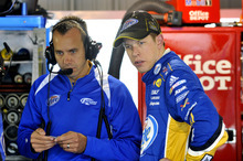 Brad Keselowski, right, and crew chief Paul Wolfe look on in the garage during practice for Sunday's NASCAR Sprint Cup Series auto race at Martinsville Speedway, Friday, Oct. 26, 2012, in Martinsville, Va. (AP Photo/Autostock, Nigel Kinrade) MANDATORY CREDIT