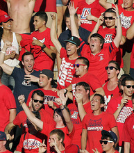 Arizona's fans react during the second half of an NCAA college football game against Southern California at Arizona Stadium in Tucson, Ariz., Saturday, Oct. 27, 2012. Arizona won 39-36. (AP Photo/John Miller)