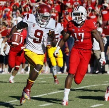 Southern California's Marqise Lee (9) runs for a touchdown as Arizona's Derrick Rainey (17) purses during the third quarter of an NCAA college football game at Arizona Stadium in Tucson, Ariz., Sat., Oct. 27, 2012. Arizona won 39-36. (AP Photo/Wily Low)