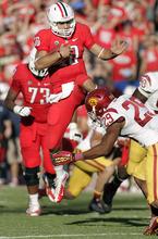Arizona's quarterback Matt Scott (10) umps over the attempted tackle of Southern California's Jawanza Starling (29) during the second half of an NCAA college football game at Arizona Stadium in Tucson, Ariz., Saturday, Oct. 27, 2012. Arizona won 39-36. (AP Photo/John Miller)