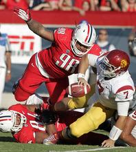 Sosuthern California's quarterback Matt Barkley (7) tries to avoid a sack by Arizona's Tevin Hood (98) during the second half of an NCAA college football game at Arizona Stadium in Tucson, Ariz., Saturday, Oct. 27, 2012. Arizona won 39-36. (AP Photo/John Miller)