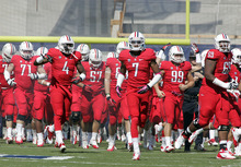 Arizona takes the field just before the start of the an NCAA college football game against Southern California with Mark Watley (7) leading the way at Arizona Stadium in Tucson, Ariz., Saturday, Oct. 27, 2012. (AP Photo/John Miller)
