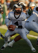 Trent Nelson  |  The Salt Lake Tribune Highland quarterback Austin Peterson looks to pass. Olympus vs. Highland, 4A high school football playoffs Friday October 26, 2012 at Olympus High School in Salt Lake City, Utah.