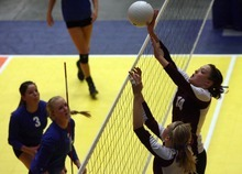 Kim Raff | The Salt Lake Tribune Morgan player Mckenzie Schenk taps the ball over the net against Dixie during the 3A state volleyball quarterfinal at the UCCU Center at Utah Valley University in Orem, Utah on October 26, 2012.