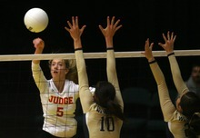 Kim Raff | The Salt Lake Tribune Snow Canyon player Megan Leavitt blocks the ball as Judge Memorial player Sydney Schafer hits the ball over the net during the 3A state volleyball quarterfinal at the UCCU Center at Utah Valley University in Orem, Utah on October 26, 2012. Monticello went on to win the match.