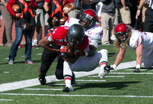 Southern Utah's Myles Crawford Harris breaks through a tackle from an Eastern Washington defender during an NCAA college football game on Saturday, Oct. 27, 2012, in Cedar City, Utah. (AP Photo/The Spectrum, Asher Swan) NO SALES; MAGS OUT