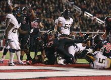 Scott Sommerdorf  |  The Salt Lake Tribune               Utah Utes running back Kelvin York (13) plows into the Ca end zone with a 1 yard TD run to make the score 21-6. Utah led Cal 28-6 at the half, Saturday, October 27, 2012.