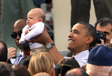 President Barack Obama holds up a baby at a campaign event at Elm Street Middle School, Saturday, Oct. 27, 2012 in Nashua, N.H. (AP Photo/Jim Cole)