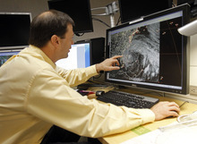 Senior hurricane specialist Dan Brown tracks Sandy as he prepares the 11:00 EDT advisory at the National Hurricane Center in Miami, Saturday, Oct. 27, 2012. Early Saturday, the storm was about 335 miles southeast of Charleston, S.C. Tropical storm warnings were issued for parts of Florida's East Coast, along with parts of coastal North and South Carolina and the Bahamas. Tropical storm watches were issued for coastal Georgia and parts of South Carolina, along with parts of Florida and Bermuda. Sandy is projected to hit the Atlantic Coast early Tuesday. (AP Photo/Alan Diaz)