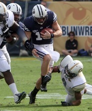 Rick Egan  | The Salt Lake Tribune   Brigham Young wide receiver JD Falslev (12) breaks a tackily as he runs for the cougars, in the second quarter, in football action BYU vs Georgia Tech, at Bobby Dodd Stadium in Atlanta, Saturday, October 27, 2012