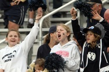 Rick Egan  | The Salt Lake Tribune   Twelve-year-old BYU fans Autumn Dustin (left) Chandler Hatch (center) and Lauren Hatch,  from Canton, Georgia, cheer for the Cougars, as BYU faced Georgia Tech, at Bobby Dodd Stadium in Atlanta, Saturday, October 27, 2012