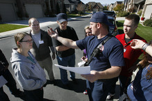 Scott Sommerdorf  |  The Salt Lake Tribune               Firefighter Richard Berry discusses the areas to be searched by volunteers prior to them going out to search neighborhoods north of 4500 South near 1500 East for missing 80 year old Fritz Helland, Sunday, October 28, 2012.