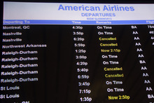 The departures board at the American Airlines terminal at LaGuardia airport shows a few cancellations, Sunday, Oct. 28, 2012 in New York. Tens of thousands of residents were ordered to evacuate coastal areas Sunday as big cities and small towns across the Northeast buttoned up against the onslaught of a superstorm. (AP Photo/Mary Altaffer)