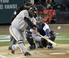 San Francisco Giants third baseman Pablo Sandoval (48) hits a single during the first inning of Game 3 of baseball's World Series against the Detroit Tigers Saturday, Oct. 27, 2012, in Detroit. (AP Photo/Charlie Riedel)