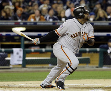 San Francisco Giants' Pablo Sandoval hits a single during the first inning of Game 3 of baseball's World Series against the Detroit Tigers Saturday, Oct. 27, 2012, in Detroit. (AP Photo/David J. Phillip)