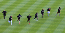 San Francisco Giants players warm up before Game 3 of baseball's World Series against the Detroit Tigers Saturday, Oct. 27, 2012, in Detroit. (AP Photo/Carlos Osorio)