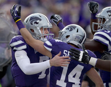 Kansas State quarterback Collin Klein (7) celebrates a touchdown with teammates Curry Sexton (14) and Tyson Williams, right, during the second half of an NCAA college football game against Texas Tech in Manhattan, Kan., Saturday, Oct. 27, 2012. (AP Photo/Orlin Wagner)