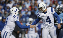 Indianapolis Colts kicker Adam Vinatieri (4) shakes the hand of holder Indianapolis Colts Pat McAfee (1) after Vinatieri kicked a field goal during the second half of an NFL football game Sunday, Oct. 28, 2012, in Nashville, Tenn. (AP Photo/Mark Humphrey)