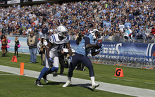 Tennessee Titans wide receiver Kendall Wright (13) makes a touch-down catch against Indianapolis Colts cornerback Cassius Vaughn (32) during the first half of an NFL football game Sunday, Oct. 28, 2012, in Nashville, Tenn. (AP Photo/Wade Payne)