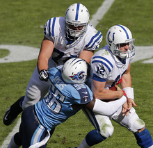 Indianapolis Colts quarterback Andrew Luck (12) is sacked by Tennessee Titans outside linebacker Akeem Ayers (56) as Indianapolis Colts tackle Anthony Castonzo (74) blocks during the second half of an NFL football game Sunday, Oct. 28, 2012, in Nashville, Tenn. (AP Photo/Joe Howell)