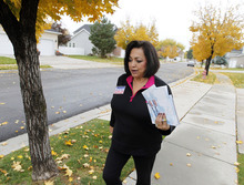 Al Hartmann  |  The Salt Lake Tribune Josie Valdez, who's running for Utah Senate District 8 walks a neighborhood to meet her constituents. The district includes most of Cottonwood Heights, Midvale and Murray.