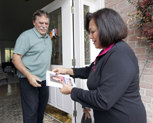Al Hartmann  |  The Salt Lake Tribune  Josie Valdez, who's running for Utah Senate District 8, stops and talks with Murray resident Michael Sandos during a neighborhood walk in her district, which includes most of Cottonwood Heights, Midvale and Murray.