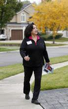AAl Hartmann  |  The Salt Lake Tribune  Josie Valdez, who's running for Utah Senate District 8 walks a neighborhood to meet her constituents in the district, which includes most of Cottonwood Heights, Midvale and Murray.