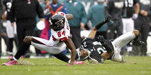 Atlanta Falcons wide receiver Roddy White (84) is tackled by Philadelphia Eagles cornerback Nnamdi Asomugha (24) during the first half of an NFL football game, Sunday, Oct. 28, 2012, in Philadelphia. (AP Photo/Mel Evans)