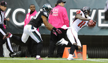 Atlanta Falcons wide receiver Julio Jones (11) scores on a 63-yard touchdown reception as Philadelphia Eagles strong safety Nate Allen, left, runs in pursuit during the first half of an NFL football game, Sunday, Oct. 28, 2012, in Philadelphia. (AP Photo/Michael Perez)
