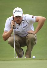 Nick Watney of the United States lines up a putt on the 18th hole during final of CIMB Classic golf tournament at the Mines Resort and Golf Club in Kuala Lumpur, Malaysia, Sunday, Oct. 28, 2012.  (AP Photo/Peter Lim)