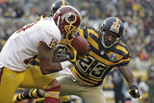 Washington Redskins wide receiver Dezmon Briscoe (19) cannot hold on to a pass as Pittsburgh Steelers cornerback Keenan Lewis (23) defends in the second quarter of an NFL football game in Pittsburgh, Sunday, Oct. 28, 2012. (AP Photo/Gene J. Puskar)