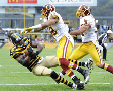 Pittsburgh Steelers tight end Leonard Pope (45) gets hit by Washington Redskins linebacker Keenan Robinson (52) as he gets into the end zone after catching a pass for a touchdown in the first quarter during an NFL football game on Sunday, Oct. 28, 2012, in Pittsburgh. (AP Photo/Don Wright)