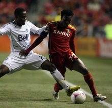 Kim Raff | The Salt Lake Tribune Real Salt Lake midfielder Kenny Mansally (29) tries to maintain possession as Vancouver FC midfielder Gershon Koffie (28) defends during a game at Rio Tinto Stadium in Sandy, Utah on October 27, 2012.