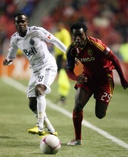 Kim Raff | The Salt Lake Tribune (right) Real Salt Lake midfielder Kenny Mansally (29) tries to maintain possession as Vancouver FC midfielder Gershon Koffie (28) defends during a game at Rio Tinto Stadium in Sandy, Utah on October 27, 2012.