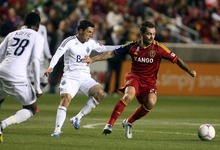 Kim Raff | The Salt Lake Tribune (right) Real Salt Lake midfielder Jonny Steele (22) pushes Vancouver FC midfielder John Thorrington (11) away as he tries to maintain possession of the ball during a game at Rio Tinto Stadium in Sandy, Utah on October 27, 2012.