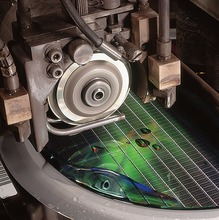 The semiconductor industry, including Micron, uses helium in the production of computer chips. Shown here: Diamond-edged blade cuts the finished wafer into individual die. Courtesy Micron
