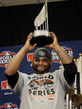 Matt Slocum | The Associated Press Giants third baseman Pablo Sandoval holds up the trophy he won after being named World Series MVP.