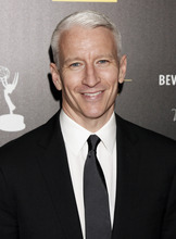 FILE - This June 23, 2012 file photo shows CNN's Anderson Cooper as he arrives at the 39th Annual Daytime Emmy Awards at the Beverly Hilton Hotel in Beverly Hills, Calif.  Cooper's daytime talk show will be wrapping after two seasons. Warner Bros. said Monday, Oct. 29, 2012,  that the marketplace made it increasingly difficult for