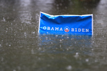 An Obama campaign sign rises above the floodwaters as rain continues to fall  in a neighborhood in  Norfolk, VA., Monday, Oct. 29, 2012.  Rain and wind from Hurricane Sandy are hitting the area.  (AP Photo/Steve Helber)