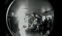 In this image made from video and released by the U.S. Coast Guard, a USCG crew member move a survivor from a sailing ship that sunk  into a helicopter. A replica tall ship caught in Hurricane Sandy's wrath began taking on water, forcing the crew to abandon the boat Monday in rough seas off the North Carolina coast. The Coast Guard rescued 14 crew members by helicopter, but two people were still missing.  (AP Photo/U.S. Coast Guard)