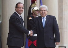 France's President Francois Hollande, left, and Cypriot President Demetris Christofias, right, shake hands for the media at the Elysee Palace in Paris, Friday, Oct. 26, 2012. (AP Photo/Michel Euler)