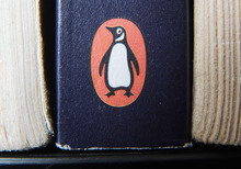 A book on display with the penguin logo. in Cirencester, England. Pearson PLC will merge its Penguin Books division with Random House, which is owned by German media company Bertelsmann, in an all-share deal that will create the world's largest publisher of consumer books, it was reported on Monday, Oct. 29, 2012. The planned joint venture brings together classic and best-selling names. As well as publishing books from authors such as John Grisham, Random House scored a major hit this year with