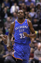 Oklahoma City Thunder forward Kevin Durant (35) runs up court in the first quarter during a preseason NBA basketball game with the Utah Jazz Friday, Oct. 12, 2012, in Salt Lake City. (AP Photo/Rick Bowmer)
