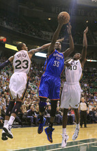 Oklahoma City Thunder forward Kevin Durant (35) drives to the basket as Utah Jazz's Trey Gilder (23) and Jeremy Evans (40) defends in the second quarter of a preseason NBA basketball game, Friday, Oct. 12, 2012, in Salt Lake City. (AP Photo/Rick Bowmer)