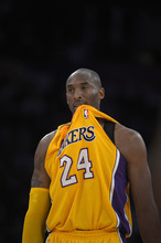 Los Angeles Lakers guard Kobe Bryant looks on during the first half of their NBA basketball game against the Sacramento Kings, Sunday, Oct.21, 2012, in Los Angeles. (AP Photo/Mark J. Terrill)